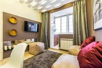 Интерьер гостиной совмещенной с балконом
